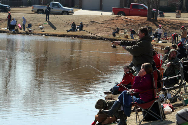 There were a lot of lines in the water during the Trout Fish Out Saturday, March 2, 2013,  morning at the Dale Robertson Activity Center pond in Yukon. PHOTO BY HUGH SCOTT FOR THE OKLAHOMAN