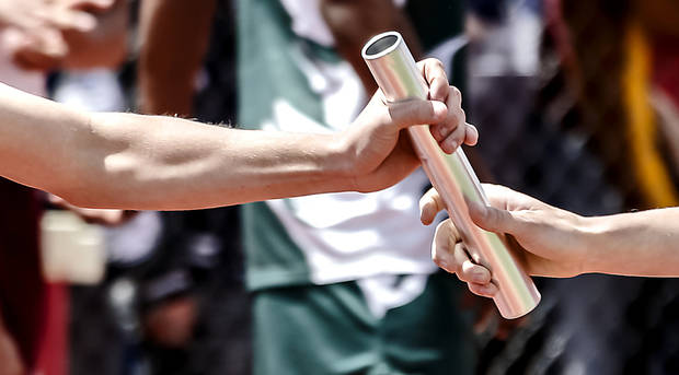 A baton is passed during boys 4x800 relay during the Class A and 2A state championship track meet at Carl Albert High School on Friday, May 3, 2013, in Midwest City, Okla. Photo by Chris Landsberger, The Oklahoman