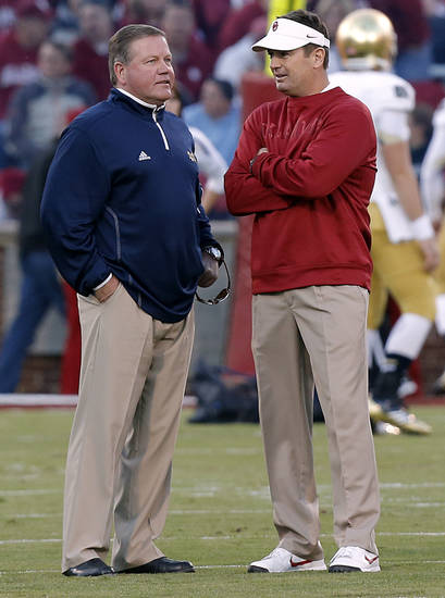 Bob Stoops talks to Notre Dame coach Brian Kelly during the college football game between the University of Oklahoma Sooners (OU) and the Notre Dame Fighting Irish at the Gaylord Family-Oklahoma Memorial Stadium on Saturday, Oct. 27, 2012, in Norman, Okla. Photo by Chris Landsberger, The Oklahoman