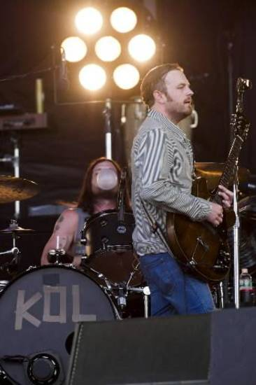 Caleb Followill, right, and Nathan Followill from the band Kings of Leon perform at the 3rd annual Governors Ball Music Festival on Saturday, June 8, 2013 in New York. (AP)