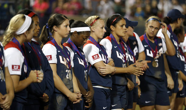USA reacts after losing to Japan in the  World Cup of Softball tournament championship game, Sunday, July 14, 2013, at the ASA Hall of Fame Stadium in Oklahoma City. Photo by Sarah Phipps, The Oklahoman