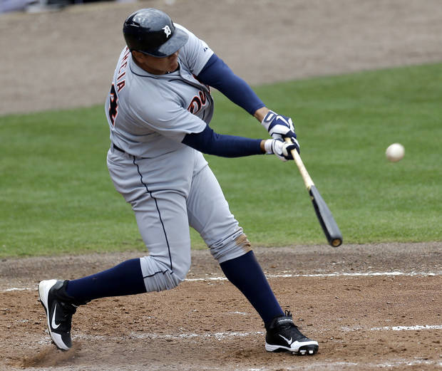 Detroit Tigers outfielder Avisail Garcia hits a home run against the New York Mets during the fifth inning of an exhibition spring training baseball game, Friday, March 1, 2013, in Port St. Lucie, Fla.  (AP Photo/Julio Cortez)