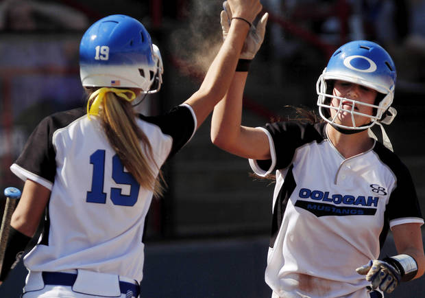 On-deck batter Baleigh Hamilton, left,  celebrates with teammate Alex Edinger as she comes to the dugout after scoring the team's sixth run during fourth inning action.  Class 4A high school championship softball game between Oologah and Piedmont at Hall of Fame Stadium in Oklahoma City on Saturday, Oct. 15, 2012.  Oologah won the game in the bottom of the sixth inning when Baleigh Hamilton scored the winning run on a hit by Alex Edinger, allowing them to claim the victory by virtue of the the run rule, defeating Piedmont,  10-0.    Photo by Jim Beckel, The Oklahoman