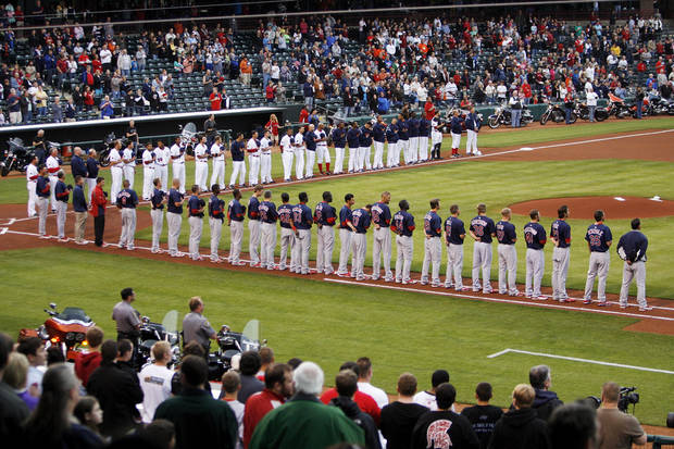 Players and fans stand for the national anthem before the 2012 opening day baseball game between the Oklahoma City RedHawks and the Memphis Redbirds at the Chickasaw Bricktown Ballpark in Oklahoma City, Thursday, April 5, 2012. Photo by Nate Billings, The Oklahoman