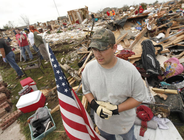 A man talks about the cleanup of the rubble of his home which was destroyed by the May 20th tornado near 145th and Robinson in Moore, OK, Saturday, May 25, 2013,  Photo by Paul Hellstern, The Oklahoman