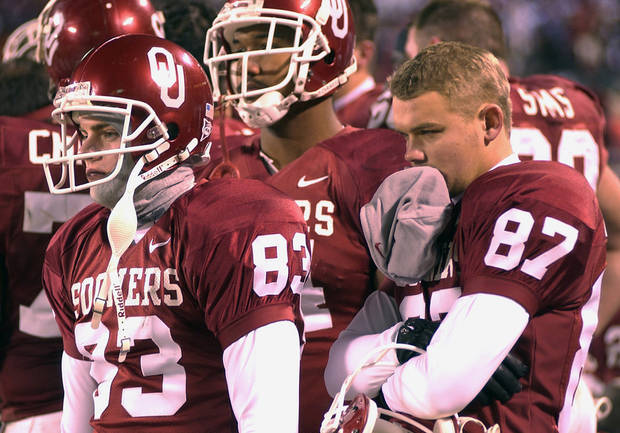 UNIVERSITY OF OKLAHOMA VS KANSAS STATE UNIVERSITY BIG 12 CHAMPIONSHIP COLLEGE FOOTBALL AT ARROWHEAD  STADIUM IN KANSAS CITY, MISSOURI, DECEMBER 6, 2003. L to R.  OU Sooner kickers #83 Trey DiCarlo and #87 Blake Ferguson watch the seconds tick off the clock as OU loses to KSU. Staff photo by Ty Russell