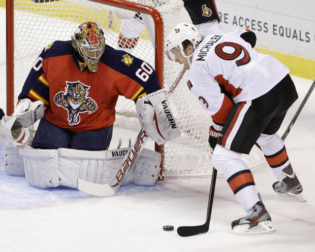 Ottawa Senators left wing Milan Michalek (9), of the Czech Republic, shoots on Florida Panthers goalie Jose Theodore (60) during the first period of an NHL hockey game, Thursday, Jan. 24, 2013, in Sunrise, Fla. (AP Photo/Wilfredo Lee)