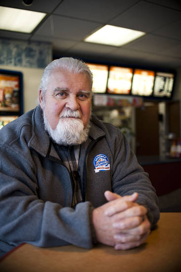 In this Oct. 29, 2012 photo, Jim Work poses in a White Castle restaurant in Flint, Mich. A quirky stunt a quarter-century ago and a 60-year relationship with a fast food chain has resulted in Jim Work, a suburban Detroit man's induction into White Castle hall of fame.  (AP Photo/The Flint Journal, Lauren Justice) LOCAL TV OUT; LOCAL INTERNET OUT