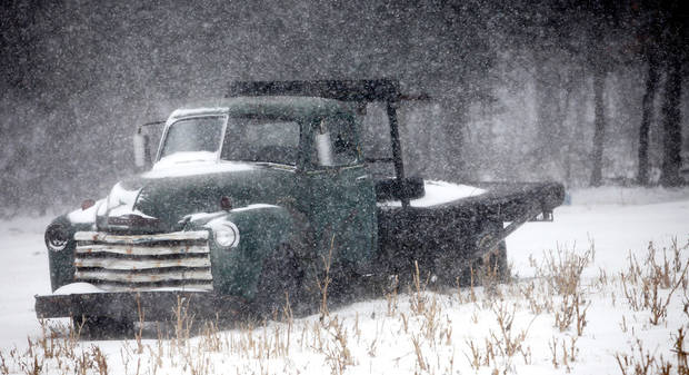 Snow covers a truck Thursday in Logan County. Photo by Steve Gooch, The Oklahoman