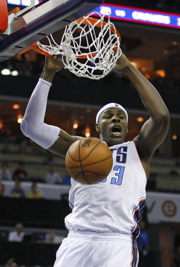 Charlotte Bobcats' Brendan Haywood dunks against the Toronto Raptors during the first half of an NBA basketball game in Charlotte, N.C., Wednesday, Nov. 21, 2012. (AP Photo/Chuck Burton)