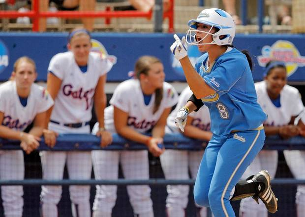 Andrea Harrison of UCLA reacts as she runs past the Florida dugout after hitting a three-run home run in the first inning during a softball game between UCLA and Florida in the first session of the Women's College World Series at ASA Hall of Fame Stadium in Oklahoma City, Thursday, June 3, 2010.  UCLA won, 16-3, in six innings. Photo by Nate Billings, The Oklahoman