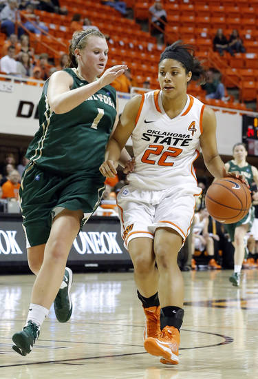 Oklahoma State's Brittney Martin (22) tries to get by Cal Poly's Kayla Griffin (1) during the women's college basketball game between Oklahoma State and Cal Poly at  Gallagher-Iba Arena in Stillwater, Okla., Friday, Nov. 9, 2012. Photo by Sarah Phipps, The Oklahoman