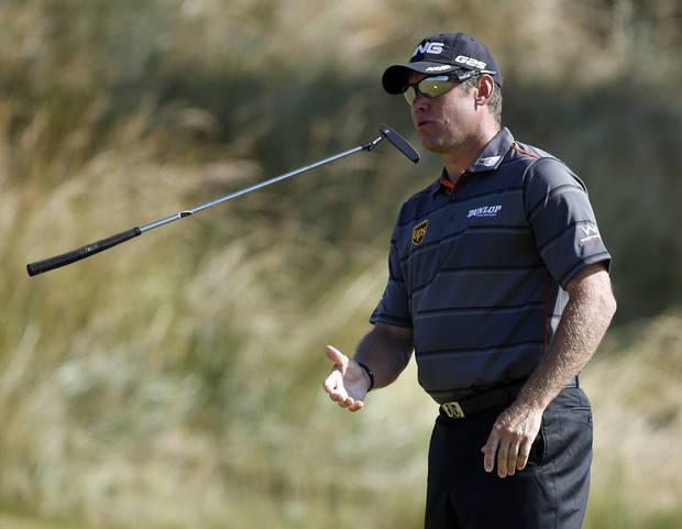 Lee Westwood of England throws his putter on the third green during the second round of the British Open Golf Championship at Muirfield, Scotland, Friday July 19, 2013. (AP Photo/Peter Morrison)