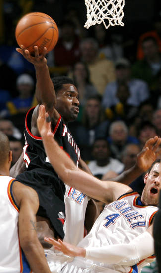 Portland's Martell Webster drives to the basket despite pressure from Oklahoma City's Nick Collisonduring their NBA basketball game at the Ford Center in Oklahoma City, Okla., on Sunday, March 28, 2010. Photo by John Clanton, The Oklahoman