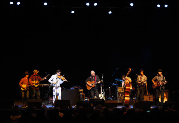 Arlo Guthrie (center) performs with Old Crow Medicine Show during the Woody Guthrie Centennial Concert at the Brady Theater Saturday March 10, 2012. (AP Photo/Christopher Smith, Tulsa World) ORG XMIT: OKTUL101