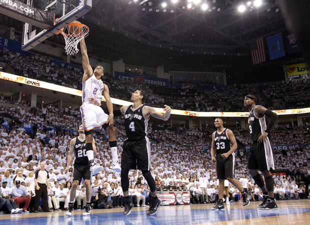 Oklahoma City's Thabo Sefolosha (2) dunks the ball over San Antonio's Danny Green (4) during Game 6 of the Western Conference Finals between the Oklahoma City Thunder and the San Antonio Spurs in the NBA playoffs at the Chesapeake Energy Arena in Oklahoma City, Wednesday, June 6, 2012. Photo by Chris Landsberger, The Oklahoman
