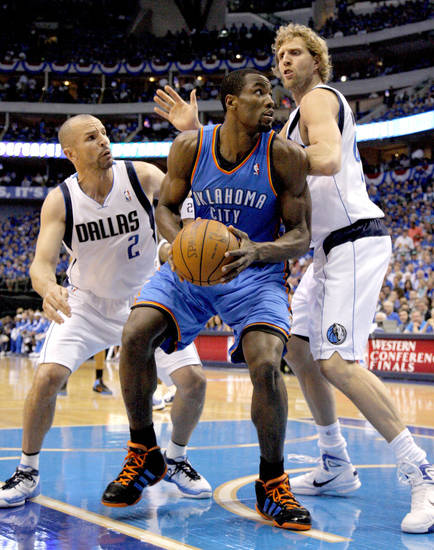 Oklahoma City's Serge Ibaka (9) tries to get past Jason Kidd (2) of Dallas and Dirk Nowitzki (41) during game 5 of the Western Conference Finals in the NBA basketball playoffs between the Dallas Mavericks and the Oklahoma City Thunder at American Airlines Center in Dallas, Wednesday, May 25, 2011. Photo by Bryan Terry, The Oklahoman