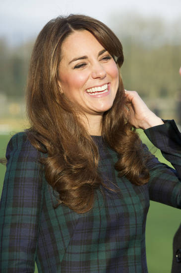 FILE - Kate, the Duchess of Cambridge seen during her visit to St. Andrew�s School, where she attended school, in Pangbourne, England, in this file photo dated Friday, Nov. 30, 2012.  The Duke and Duchess of Cambridge are very pleased to announce that the Duchess of Cambridge is expecting a baby, St James's Palace officially announced Monday Dec. 3, 2012. (AP Photo/Arthur Edwards, File)