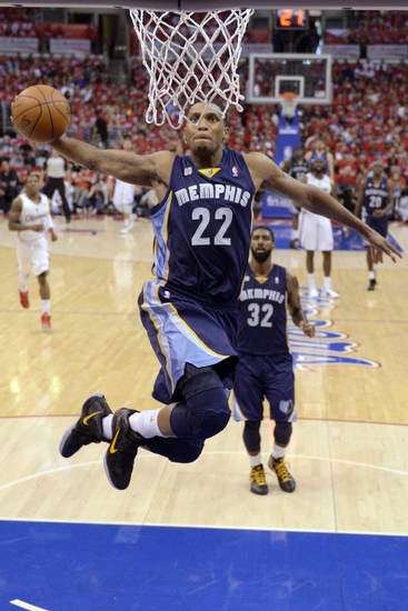 Memphis Grizzlies forward Rudy Gay (22) dunks as guard O.J. Mayo (32) watches during the first half of Game 3 in their first-round NBA basketball playoff series against the Los Angeles Clippers, Saturday, May 5, 2012, in Los Angeles. (AP Photo/Mark J. Terrill)