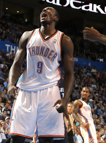 Oklahoma City's Serge Ibaka (9) celebrates a basket during the preseason NBA game between the Oklahoma City Thunder and the Charlotte Bobcats at Chesapeake Energy Arena in Oklahoma City, Tuesday, Oct. 16, 2012. Photo by Sarah Phipps, The Oklahoman