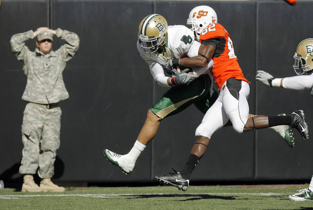 OSU's Isaiah Anderson (82) tries to stop Byron Landor (14) of Baylor after Landor recovered an OSU fumble in the third quarter during the college football game between the Oklahoma State University Cowboys (OSU) and the Baylor University Bears at Boone Pickens Stadium in Stillwater, Okla., Saturday, Nov. 6, 2010. OSU won, 55-28. Photo by Nate Billings, The Oklahoman