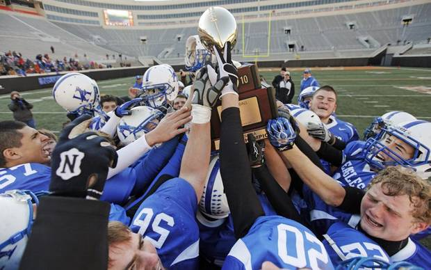 The Hennessey Eagles celebrate with the gold ball championship trophy after the Class 2A high school football championship game between Hennessey and Davis at Boone Pickens Stadium in Stillwater, Okla., Saturday, December 11, 2010. Hennessey won, 14-0. Photo by Nate Billings, The Oklahoman ORG XMIT: KOD