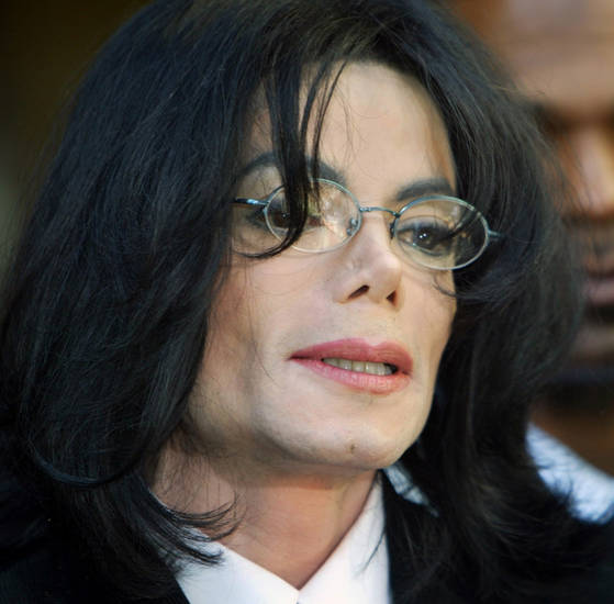 FILE - In this April 30, 2004 file picture, Michael Jackson speaks at a news conference after his arraignment at the Santa Maria, Calif. courthouse. (AP Photo/Pool, Stephen Osman) ORG XMIT: NYET715