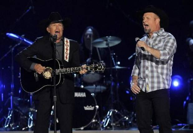 "George Strait, left, and Garth Brooks perform ""Cowboy Rides Away"" at the 48th Annual Academy of Country Music Awards at the MGM Grand Garden Arena in Las Vegas on Sunday, April 7, 2013. (AP)"