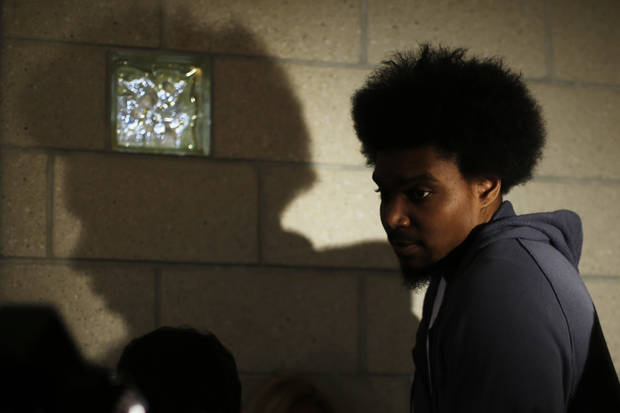 Philadelphia 76ers' Andrew Bynum walks away after speaking to members of the media at the team's NBA training facility Friday, March 1, 2013, in Philadelphia. (AP Photo/Matt Rourke)