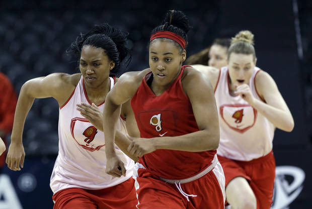 Georgia's Jasmine Hassell, center, leads teammates as they run during practice for a regional semifinal game in the women's NCAA college basketball tournament Friday, March 29, 2013, in Spokane, Wash. Georgia plays Stanford on Saturday. (AP Photo/Elaine Thompson)