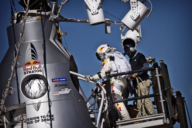 In this photo provided by Red Bull Stratos, pilot Felix Baumgartner of Austria steps into his capsule before his mission was aborted due to high winds during the final manned flight of Red Bull Stratos in Roswell, N.M., Tuesday, Oct. 9, 2012. (AP Photo/Red Bull Stratos, Balazs Gardi)