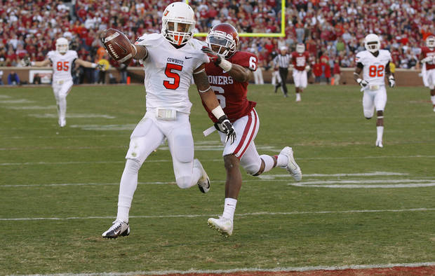 Oklahoma State's Josh Stewart (5) scores a touchdown past Oklahoma's Demontre Hurst (6) during the Bedlam college football game between the University of Oklahoma Sooners (OU) and the Oklahoma State University Cowboys (OSU) at Gaylord Family-Oklahoma Memorial Stadium in Norman, Okla., Saturday, Nov. 24, 2012. Oklahoma won 51-48. Photo by Bryan Terry, The Oklahoman