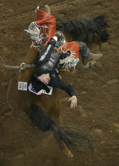 Tim O'Connell rides Cool Change during Bareback riding the National Circuit Finals Rodeo at the State Fair Arena in Oklahoma City, Friday, April 5, 2013. Photo by Sarah Phipps, The Oklahoman