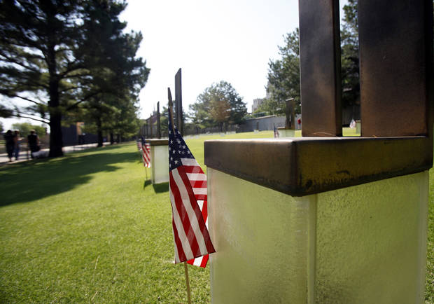 American flags stand next to each of the chair monuments at the Oklahoma City National Memorial and Museum on July 1, 2013. The flags were placed by members of the memorial facilites staff in observance of Independence Day. Photo by Aliki Dyer, The Oklahoman