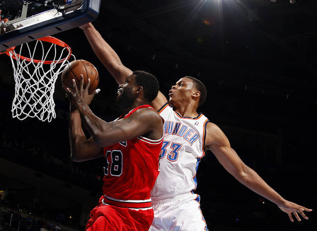 Oklahoma City&#039;s Daniel Orton (33) defends as Chicago&#039;s Nazr Mohammed (48) defends during the NBA game between the Oklahoma City Thunder and the Chicago Bulls at Chesapeake Energy Arena in Oklahoma City, Sunday, Feb. 24, 2013. Photo by Sarah Phipps, The Oklahoman