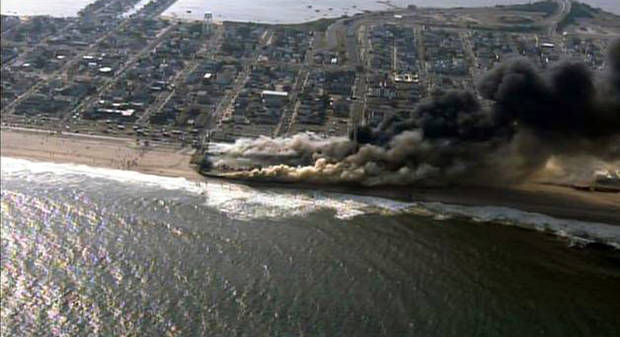 This frame grab from video provided by Fox 29 shows a raging fire in Seaside Park, N.J. on Thursday, Sept. 12, 2013.  The fire apparently started in an ice cream shop and spread several blocks down  the New Jersey shore boardwalk that was damaged in Superstorm Sandy (AP Photo/Fox 29) MANDATORY CREDIT
