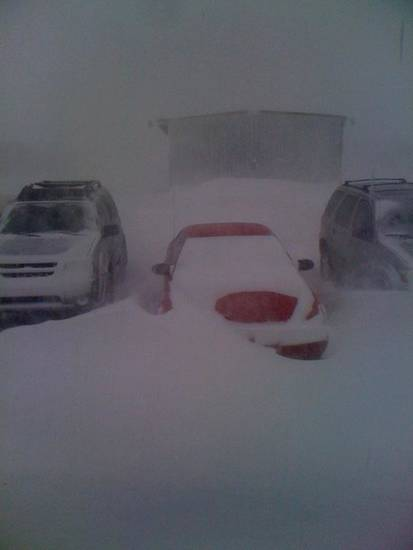 Our parking lot at Air Evac EMS in Elk City. The drifts were up to 4 feet around the cars and in front of the office.  Submitted by Steve Selby.