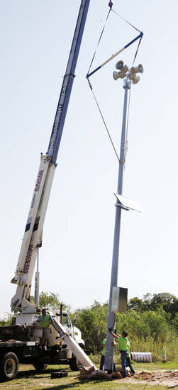 A new siren is  installed at Eagle Lake in Del City on Wednesday. Del City is installing eight new sirens around town. Photo by Paul B. Southerland, The Oklahoman <strong>PAUL B. SOUTHERLAND - PAUL B. SOUTHERLAND</strong>