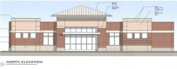 Proposed new Chase branch to be built at Dean A. McGee. The design calls for a brick and stucco facade with a metal pitched roof.