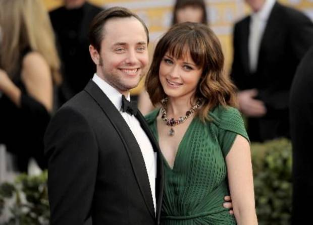 his Jan. 27, 2013 file photo shows actors Vincent Kartheiser, left, and Alexis Bledel at the 19th Annual Screen Actors Guild Awards at the Shrine Auditorium in Los Angeles. Bledel's publicist, Meghan Prophet, is confirming the news that the couple is engaged. The 33-year-old Kartheiser plays ad man Pete Campbell on the hit AMC network drama &quot;Mad Men,&quot; and Bledel, 31, is best known for her role as the teenage daughter in the long-running series &quot;Gilmore Girls.&quot; (Photo by Chris Pizzello/Invision/AP, file)