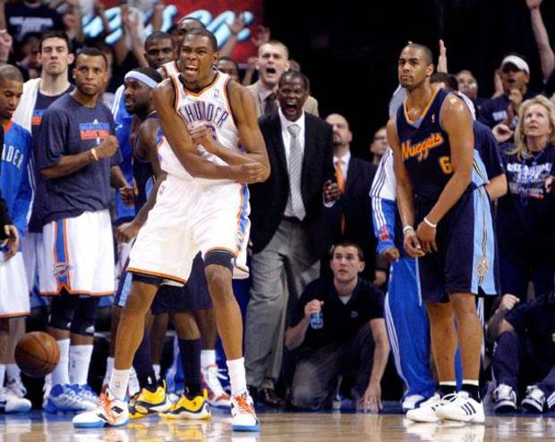 Oklahoma City's Kevin Durant (35) reacts after making a block as Denver's Arron Afflalo (6) reacts during the NBA basketball game between the Denver Nuggets and the Oklahoma City Thunder in the first round of the NBA playoffs at the Oklahoma City Arena, Wednesday, April 27, 2011. Photo by Sarah Phipps, The Oklahoman