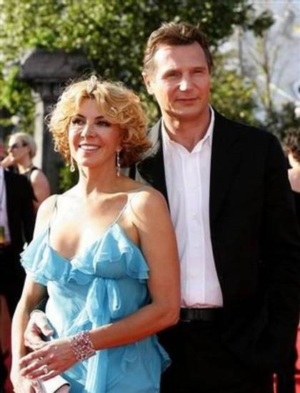 Actor Liam Neeson, right, and his wife Natasha Richardson arrive for the U.K. premiere of his new movie 'The Chronicles of Narnia: Prince Caspian' at the O2 Arena in east London, Thursday, June 19, 2008. (AP Photo/Akira Suemori)