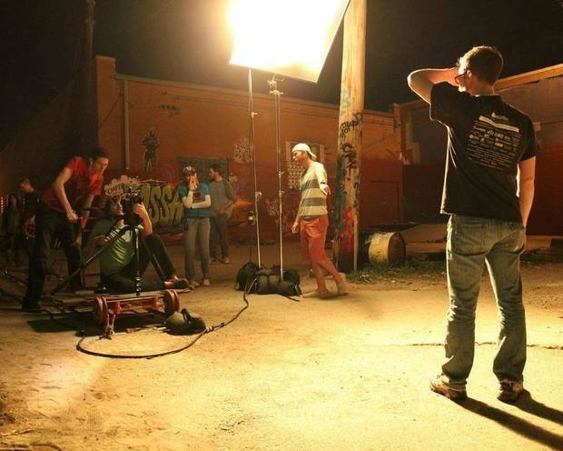 "Producer/director Kyle Roberts, center, works with his crew in Oklahoma City's Automobile Alley during a night shoot for the Oklahoma-made coming-of-age superhero movie, ""The Posthuman Project."" Photo provided by Reckless Abandonment Pictures"