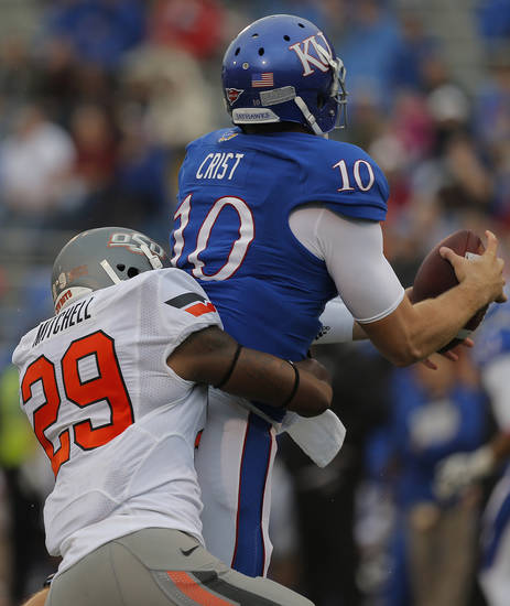 Oklahoma State's Joe Mitchell (29) sacks Kansas' Dayne Crist (10) during the college football game between Oklahoma State University (OSU) and the University of Kansas (KU) at Memorial Stadium in Lawrence, Kan., Saturday, Oct. 13, 2012. Photo by Sarah Phipps, The Oklahoman