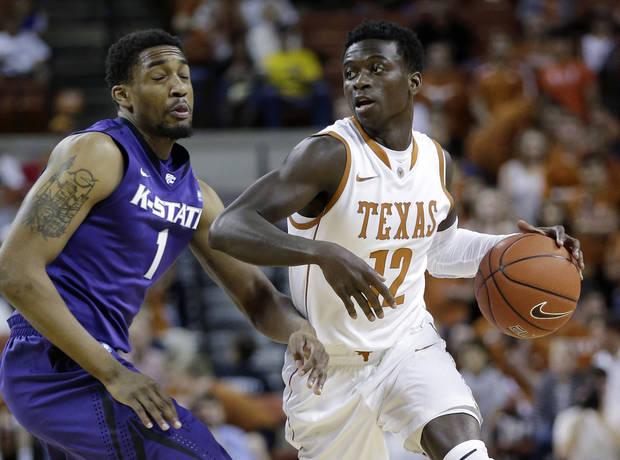 Texas' Myck Kabongo (12) works the ball around Kansas State's Shane Southwell (1) during the first half on an NCAA college basketball game, Saturday, Feb. 23, 2013, in Austin, Texas. (AP Photo/Eric Gay)
