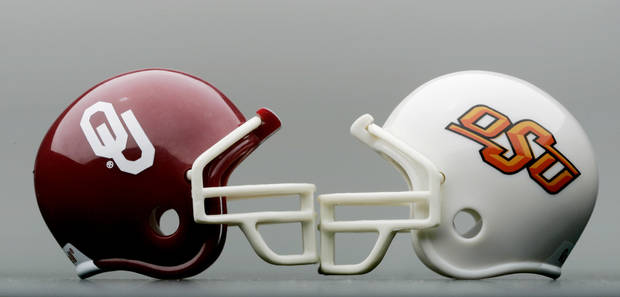 OU and OSU football helmets.  By Bryan Terry/The Oklahoman