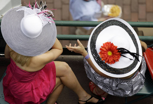 Spectators chat in their grand stand seats before the 138th Kentucky Derby horse race at Churchill Downs Saturday, May 5, 2012, in Louisville, Ky. (AP Photo/Charlie Riedel)  ORG XMIT: DBY145