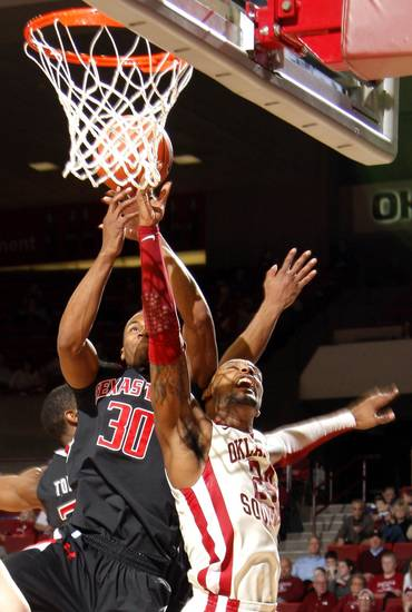 Oklahoma's Romero Osby (24) shoots as Texas Tech's Jaye Crockett (30) defends during the men's college basketball game between the University of Oklahoma  and Texas Tech University of at the Lloyd Nobel Center in Norman, Okla., Tuesday, Jan. 17, 2012. Photo by Sarah Phipps, The Oklahoman