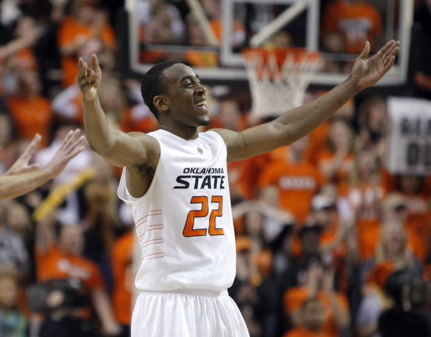Oklahoma State's Markel Brown (22) celebrates during the Bedlam men's college basketball game between the University of Oklahoma Sooners and Oklahoma State University Cowboys at Gallagher-Iba Arena in Stillwater, Okla., Saturday, February, 5, 2011. Photo by Sarah Phipps, The Oklahoman