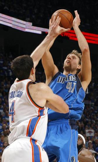 Dirk Nowitzki (41) of Dallas shoots over Oklahoma City's Nick Collison (4)during game 3 of the Western Conference Finals of the NBA basketball playoffs between the Dallas Mavericks and the Oklahoma City Thunder at the OKC Arena in downtown Oklahoma City, Saturday, May 21, 2011. Photo by Sarah Phipps, The Oklahoman